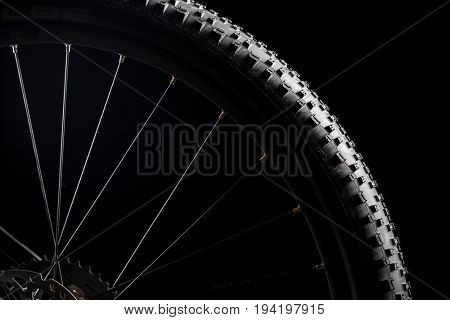 Modern MTB race mountain bike isolated on black background in a studio