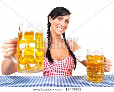 Original bavarian traditional beerfest woman with dirndl with beer maas glas celebrating the oktoberfest