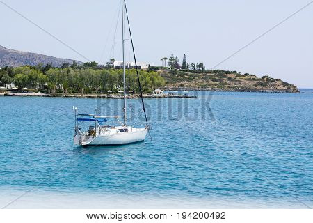 Beautiful Seascape With White Sailing Yacht In The Blue Sea. Lowered The Sails, Calm. The Concept Of