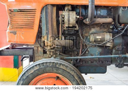 workshop retro orange tractor Repair diesel engine
