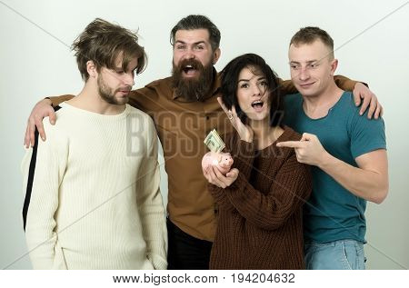 group of friends or people cute woman or pretty girl and three men in casual wear pointing at dollars money in piggy bank on white background. Savings budget finance cash and moneybox