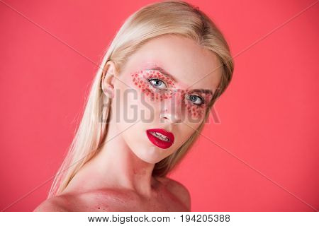 woman eyes speckled with red fashion makeup or creative make up of blonde girl