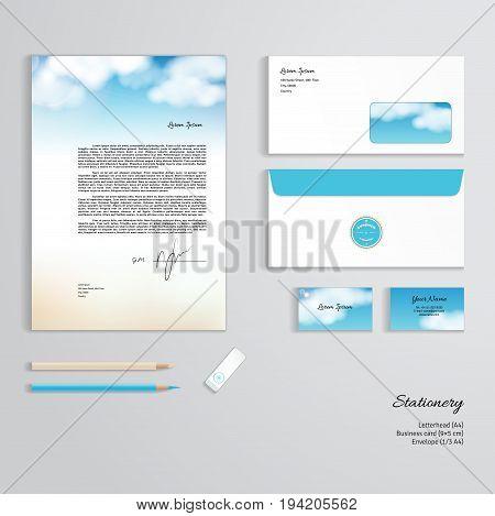 Vector corporate identity templates. Sky clouds sunshine and sandy beach. Letterhead envelope business card pencils eraser.