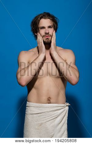 Man With Towel Has Bare Muscular Torso