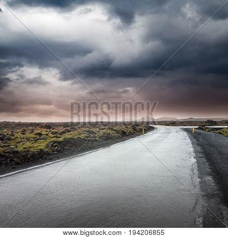 Empty Rural Road Under Dark Dramatic Stormy Sky
