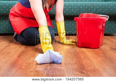 Maid Woman Sit And Cleans The Floor