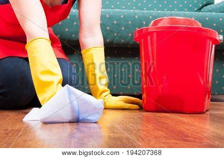 Closeup Of Woman Washing Floor At Home