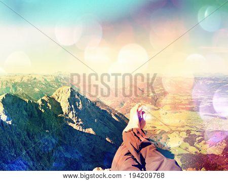 Film Grain Effect.  The Crossed Legs Take A  Rest On Tiring Mountain Trail. Sweaty Male Legs Relaxin