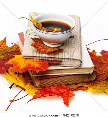still life with autumn leaves books and tea