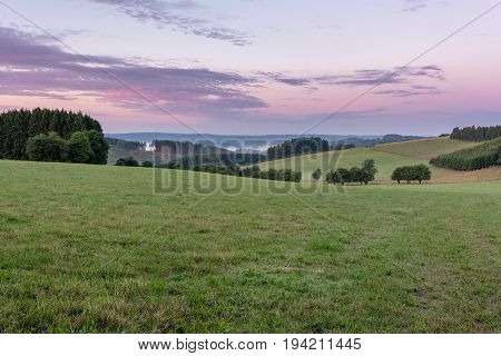Belgian countryside - Ardennes. View over the Semois valley covered by clouds in the Belgian Ardennes in the early morning.