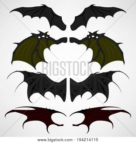 Vector cartoon set of black dark devils wings