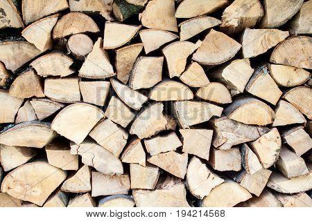 Big stack of chopped firewood. Woodpile. Close-up.