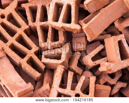 Pile of broken silicate bricks. Close up.
