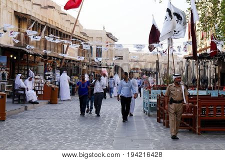 DOHA, QATAR - JULY 6, 2017: Flags and bunting show loyalty to Qatari Emir Sheikh Tamim bin Hamad in the capital's Souq Waqif market during the diplomatic crisis between Qatar and neighbouring states