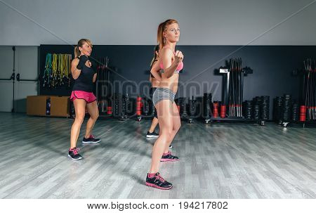 Group of beautiful women in a hard boxing training on fitness center