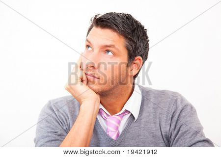 Thinking handsome man looking sideway wondering for ideas for business innovation