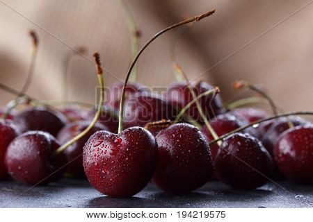 Bright Juicy Cherry Berries On A Baggy Background.