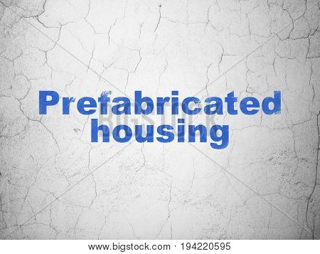 Building construction concept: Blue Prefabricated Housing on textured concrete wall background