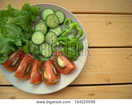 The best lunch to lose weight, salad, cuted tomatoes, cucumber, green paprika.