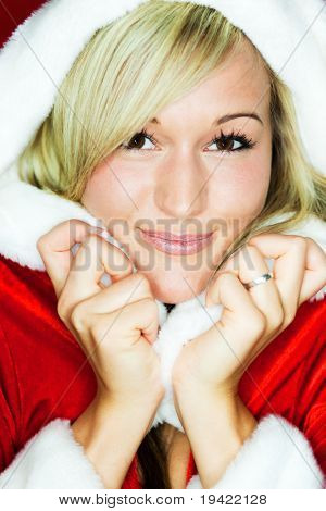 Santa mrs christmas girl in red with background holding and opening golden gift present