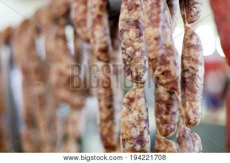 Strings of t raditional spanish hard cured sausage fuet