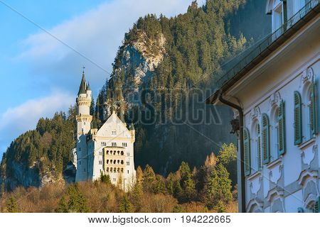 Neuschwanstein Castle the famous castle in Germany located in Fussen, Bavaria, mountains and blue sky