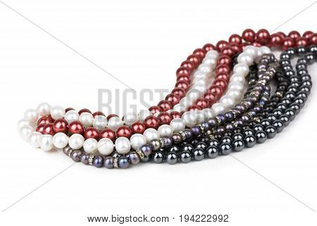 beads of different pearls on a white background