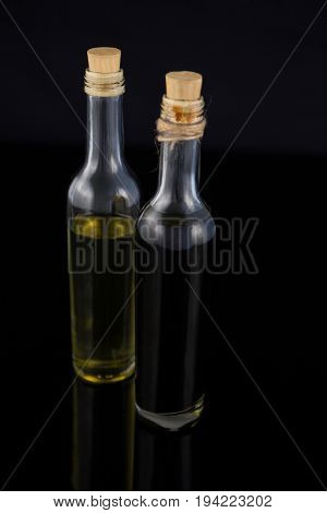 Close-up of olive oil and balsamic vinegar in bottle