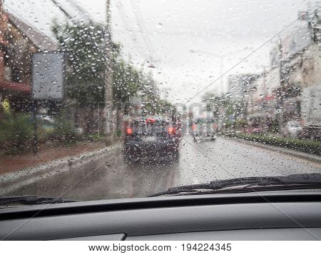 Road View Through Car Windshield With Rain Drops, Driving In Rain.