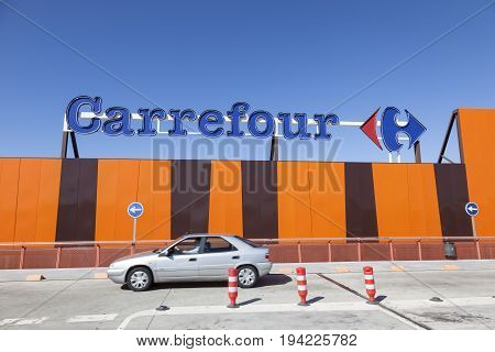 Huelva Spain - June 3 2017: Subsidiary of the french supermarket chain Carrefour in the city of Huelva Andalusia Spain