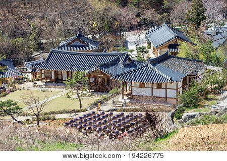 Kimchi pots in front of traditional Korean houses at Wanju County South Korea