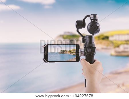 Smartphone shooting concept Isle of Wight tourist attraction in summer England UK.