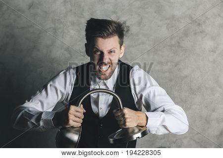 Businessman Breaking Lamp