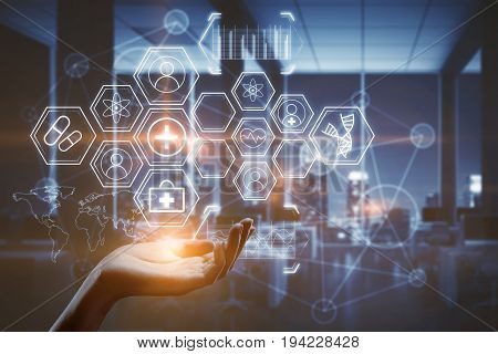Hand holding abstract glowing medical icons on blurry interior background. Futuristic concept. Double exposure