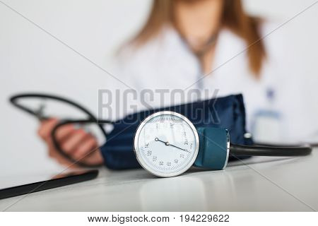 Close-up shot of pulsimeter and doctor on background.
