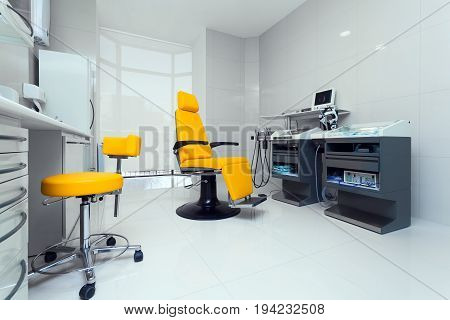 Modern yellow medical room with new equipment