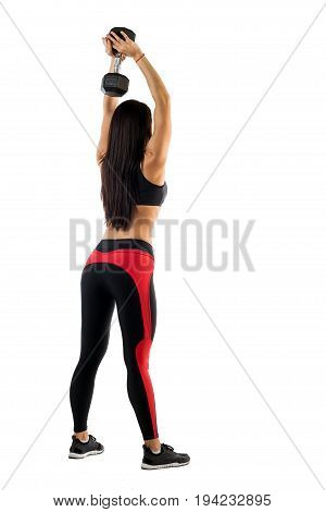 Sports woman fitness model doing exercises with dumbbells hands behind head in straight position side view on white background. Examples of exercises with dumbbells