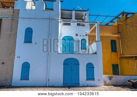 Colorful houses in Alghero seafront. Sardinia Italy