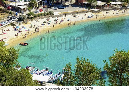 PALEOKASTRITSA CORFU GREECE - JULY 3 2017: Aerial view on the bay and beach Palaiokastritsa with crystal sea water on the Island Corfu Greece.