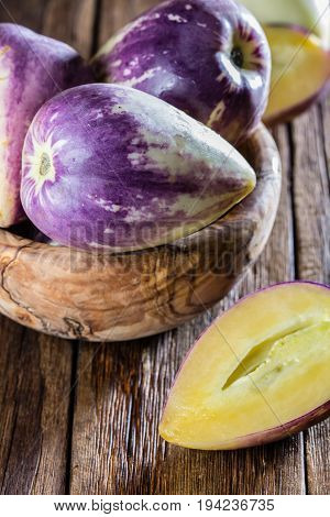 South American fruit sweet cucumber. Pepino dulce or pepino melon on wooden background
