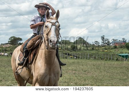 Marelli Province Maldonado Uruguay - November 118 2012: The young gaucho participates in the Traditional Holiday lasso and dressage
