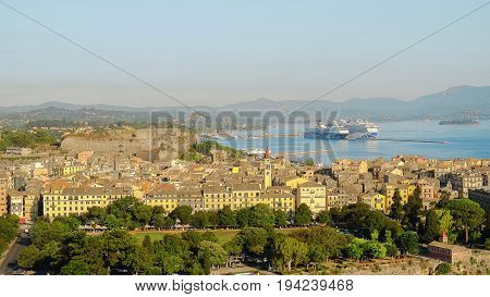 CORFU GREECE - JULY 05 2017: Aerial view on the old town of the capital of the Island Corfu Kerkira with a new fortress Fortezza Nuova and large cruise ships in the new port of the town.