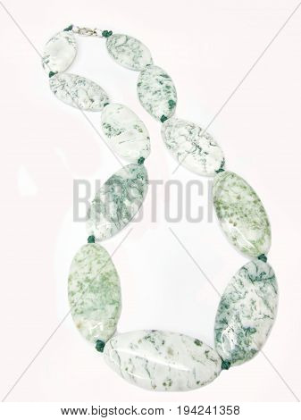 jewelry green and white beads isolated on white background