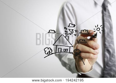 Businessman drawing model  the house