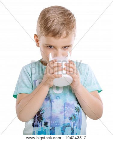 Close-up pretty little boy is drinking milk shake. Charming kid is drinking organic milk isolated on a white background. Adorable small boy is drinking fresh milk.