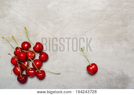 Sweet Wild Red Cherries On Concrete Background