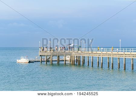 SALINAS, ECUADOR, JULY - 2016 - People at large dock at pacific ocean in Salinas Ecuador