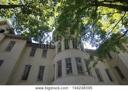 Looking up at an old mental hospital building