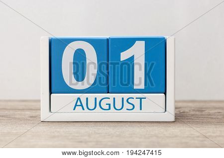 August 1st. Image of august 1, close-up wooden color calendar on white background. Summer day.