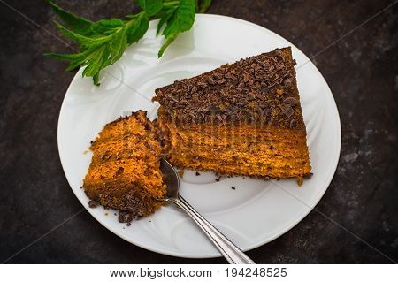 Cake With Chocolate, Honey And Mint. Black Background. Top View. Close-up